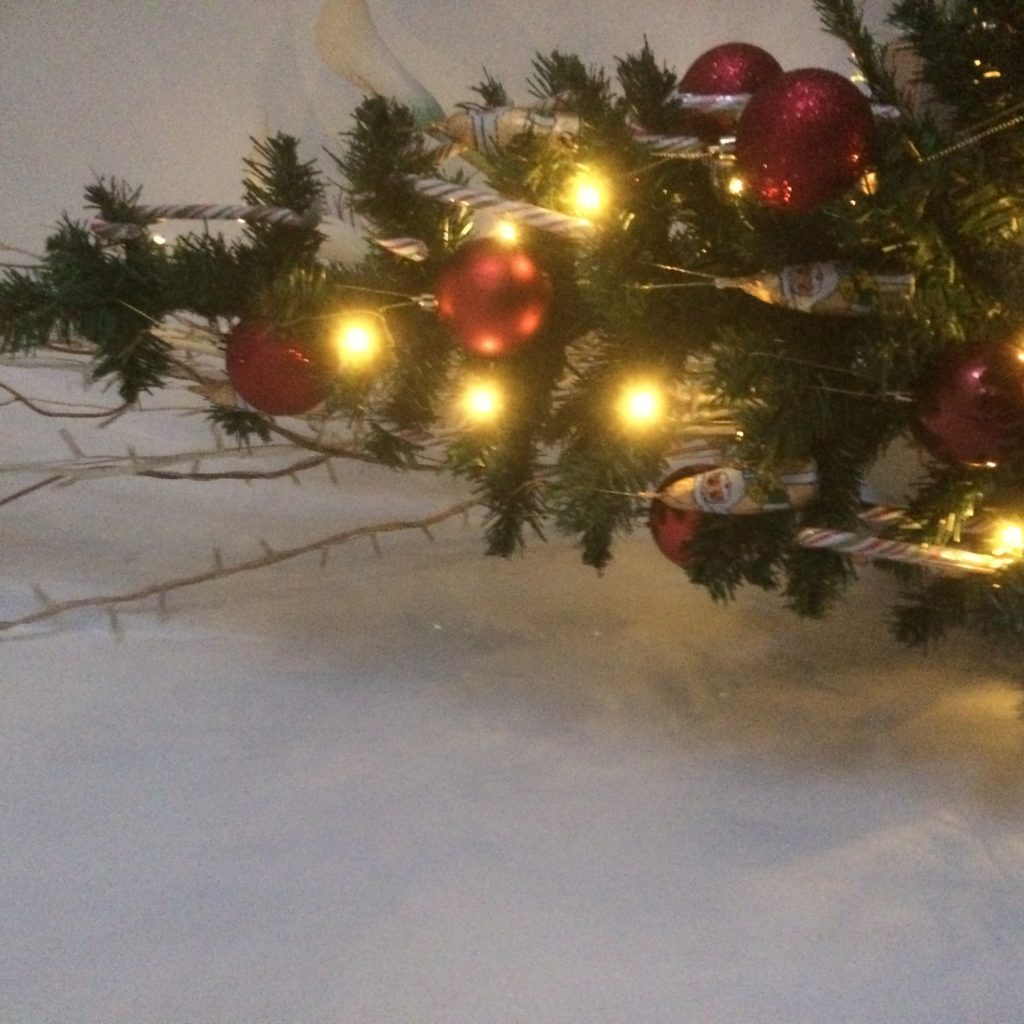 A small Christmas tree with lights and decorations