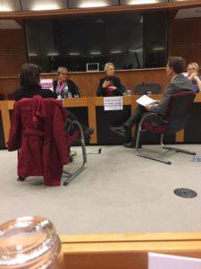 Helga Stevens speaking with a sign interpreter.
